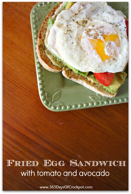 Fried Egg Sandwich with Tomato and Avocado on Whole Wheat Toast