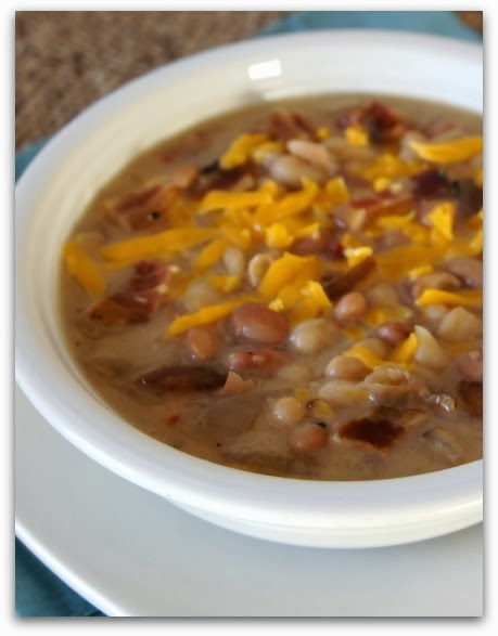 Recipe for Crock Pot Cheddar, Bacon and Bean Soup...this is a perfect recipe to make if you're going to be gone all day! #soup #crockpot #slowcooker