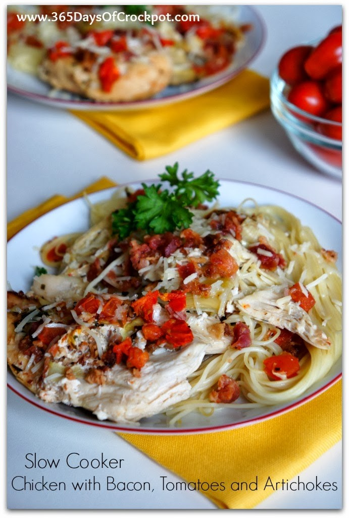 Slow Cooker Tomato Bacon Artichoke Chicken--Three of my favorite foods are bacon, tomatoes and artichokes. So how could I go wrong with this dish? This flavorful chicken and sauce is served over rice, barley, noodles or mashed potatoes and then I topped mine fresh, diced tomatoes for a little color. This is a yummy meal to serve a hungry family on any night of the week!