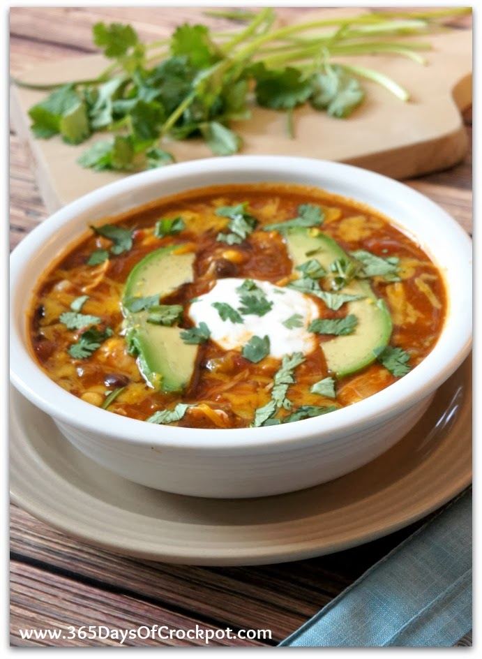 Slow Cooker Chicken Enchilada Soup–all the flavors of chicken enchiladas in a bowl of soup. The soup is thickened up with a can of refried beans instead of dairy…this soup can be made dairy free if you want it to be. This version is made in your slow cooker.