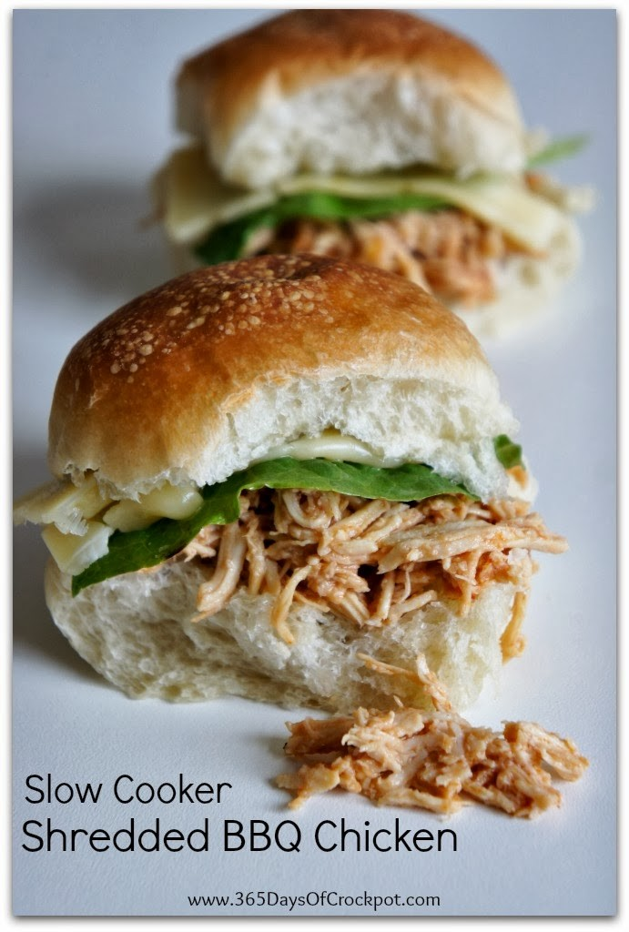 An easy 5 ingredient recipe for Slow Cooker Shredded BBQ Chicken.  Serve the tender meat on slider buns, salad or even pizza!  Easy dinner that the whole family will love.  #crockpot #slowcooker