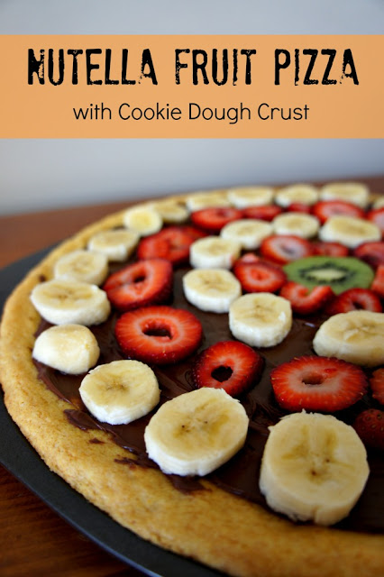 Nutella Fruit Pizza...tastes as good as it looks AND it only takes about 25 mintues from start to finish to make!