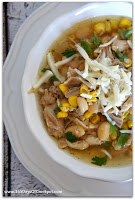 Chicken chili with white beans and a Mexican flare thanks to cilantro, diced avocado and lime juice!