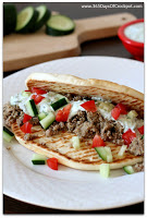 "These slow cooker Greek ground turkey pitas with tzatziki sauce have all the fun flavors of gyros but with ground turkey meat instead of lamb. Why not mix up taco night and make these Greek ""tacos"" instead of plain old regular tacos. This recipe is so easy that anybody--even your kids--can make it!"