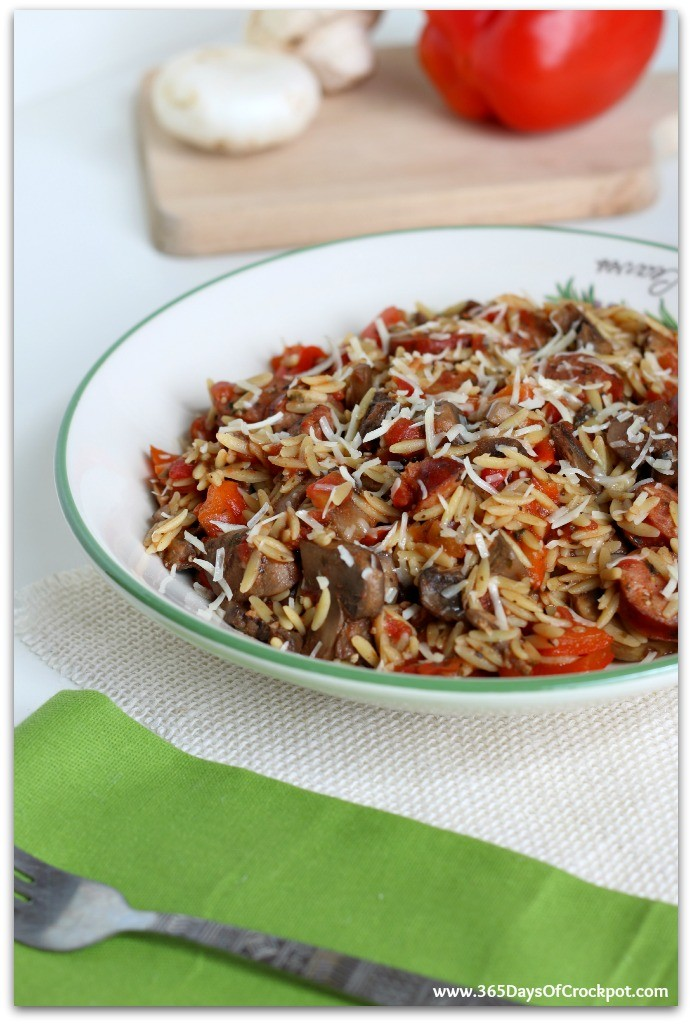 Instant Pot Smoked Sausage with Parmesan and Orzo--smoked sausage, peppers, mushrooms, tomatoes, orzo and parmesan cheese cooked quickly in your pressure cooker. This meal is loaded with flavor and is a dump and go one pot meal.