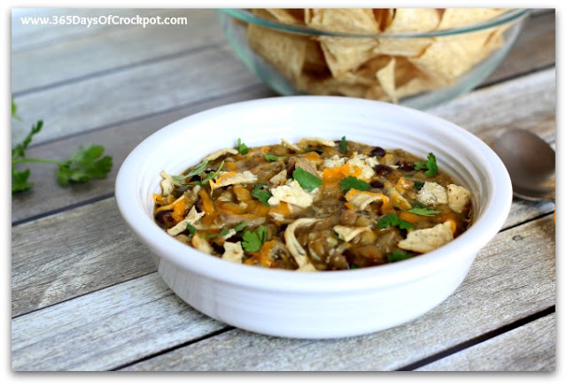 Lentils and chicken are slow cooked with green salsa and black beans to make a creamy one pot dinner. Top it with cheddar, sour cream, cilantro and crunched up tortilla chips for the ultimate Mexican meal