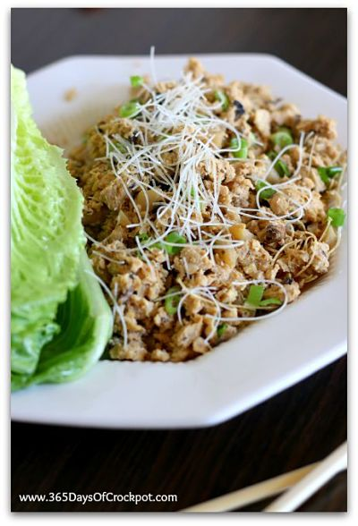 Slow Cooker PF Chang's Lettuce Wraps: Ground chicken, mushrooms, green onion, water chestnuts and crispy rice sticks all rolled up into crisp leaves of lettuce.