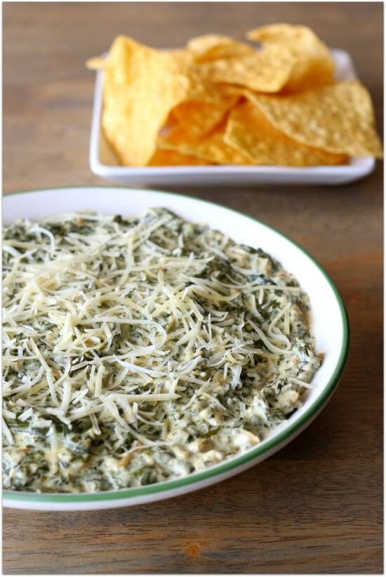Creamy, cheesy slow cooker spinach dip with tortilla chips
