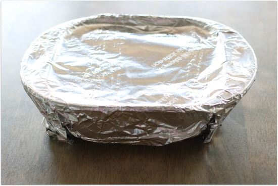 cover the dish tightly with foil before placing it in the oven