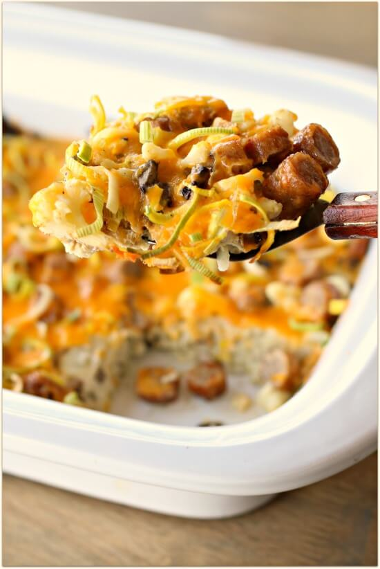 A savory, low carb breakfast casserole made in the slow cooker with eggs, cauliflower, leeks, mushrooms, sausage and shredded sharp cheddar cheese.