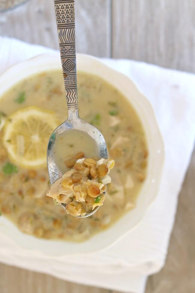 "Slow Cooker Lemon Lentil Chicken Soup: a brightly flavored chicken and lentil soup based on the Greek Classic avgolemono, which translates as ""egg-lemon."" It is a light and healthy soup that can be served as a starter or as the main dish."