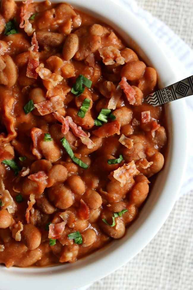Instant Pot Homemade Pork and Beans--your childhood favorite pork n' beans made at home in your Instant Pot with dried beans and lots of crispy bacon and just a couple other pantry staples.