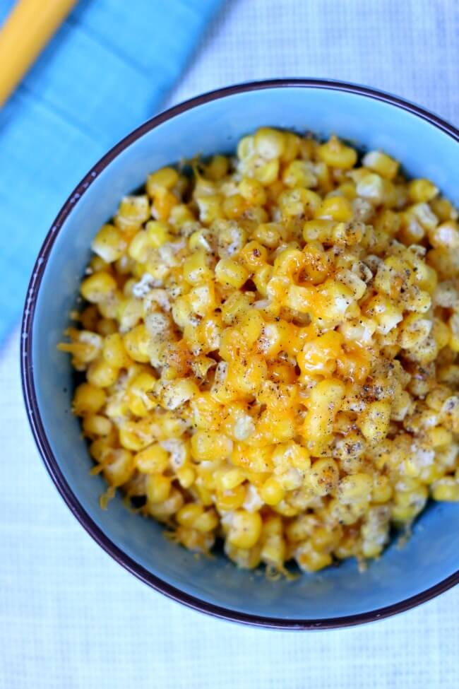 Slow Cooker Cheesy Creamed Corn: an easy slow cooker recipe for a indulgent, cheesy and creamy corn dish that is perfect for a special holiday meal.