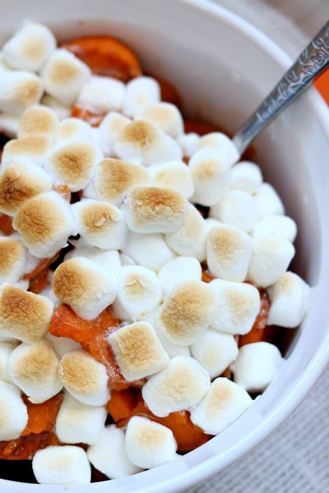 Slow Cooker Marshmallow Sweet Potatoes: a traditional holiday side dish made in your slow cooker to free up oven and stovetop space for all the other food that you'll be making!