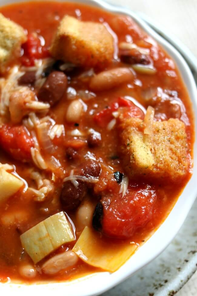 Tomato Artichoke 15-Bean Soup--a healthy soup with crushed tomatoes, tender fleshy artichoke hearts, a variety of hearty beans, Parmesan cheese and seasoned croutons.