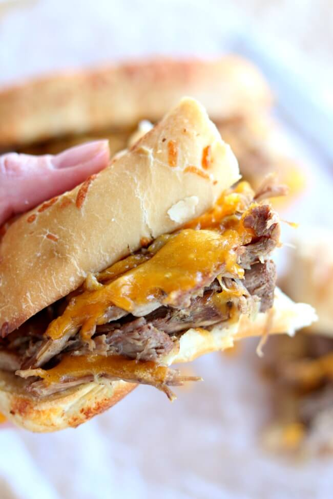 Instant Pot Beef and Cheddar Sandwiches--the easiest recipe to make ever. With only 5 ingredients total (beef, broth, onion soup mix, cheddar and sandwich buns) you may be thinking that this recipe is just too easy to taste good. Well, you're wrong :) The flavor is amazing and your family will be asking for seconds.