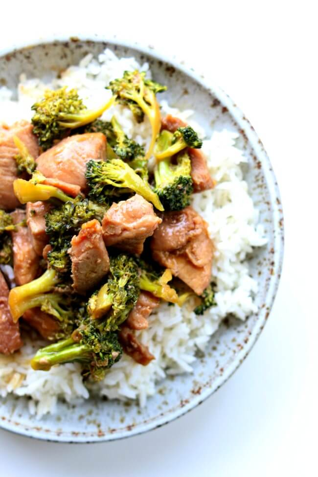 Slow Cooker Pork and Broccoli--you've heard of Asian beef and broccoli but I'm mixing it up today by using pork sirloin instead. This gluten free crockpot recipe is super easy but it will make you feel like you're eating at your favorite Chinese restaurant. Tender pieces of pork and a super savory sauce with semi-cooked broccoli all go together nicely over white rice.