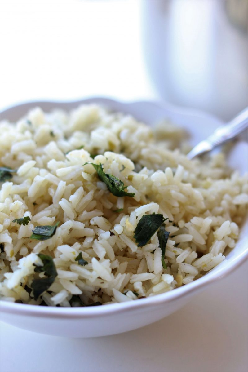 Instant Pot Cafe Rio Cilantro Lime Rice--this quickly cooked seasoned rice made in you pressure cooker is just like Cafe Rio's and it makes the perfect addition to any Mexican dish for dinner.