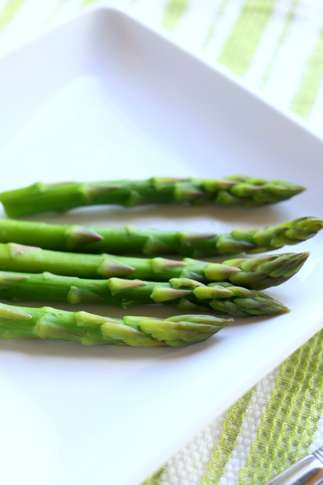 Instant Pot Steamed Asparagus--1 minute of cooking time is all your little asparagus spears need in the pressure cooker. They turn out perfectly steamed--not limp and overcooked and not too crisp.