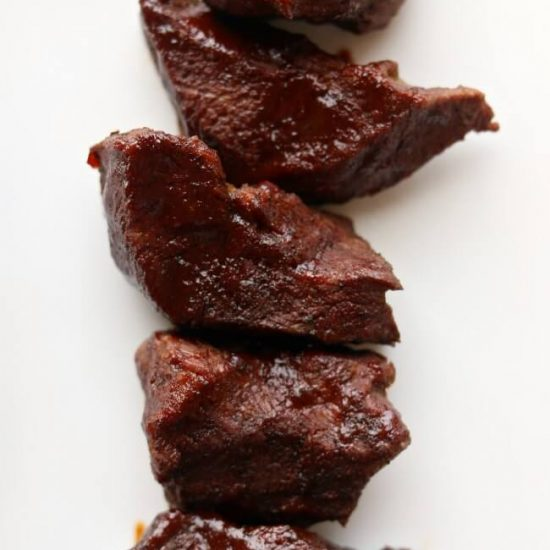 Instant Pot Beef Short Ribs--Tender pieces of beef that have been rubbed with a dry rub and then cooked in the pressure cooker and then basted with barbecue sauce.