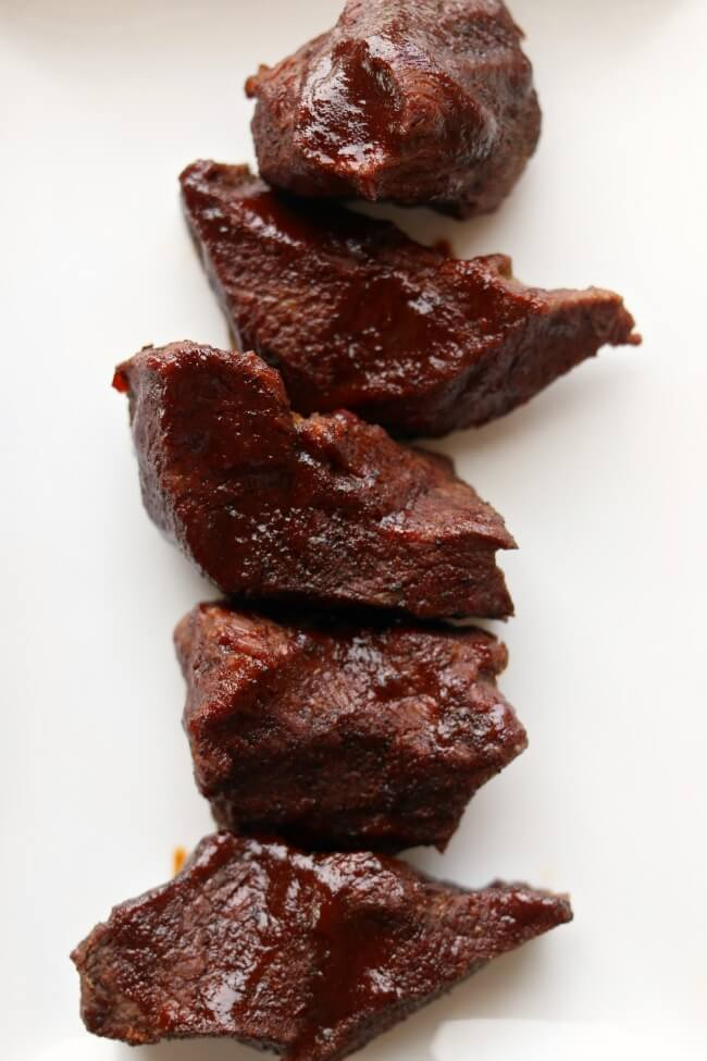 Instant Pot (or Crockpot) Beef Short Ribs--Tender pieces of beef that have been rubbed with a dry rub and then cooked in the pressure cooker and then basted with barbecue sauce.