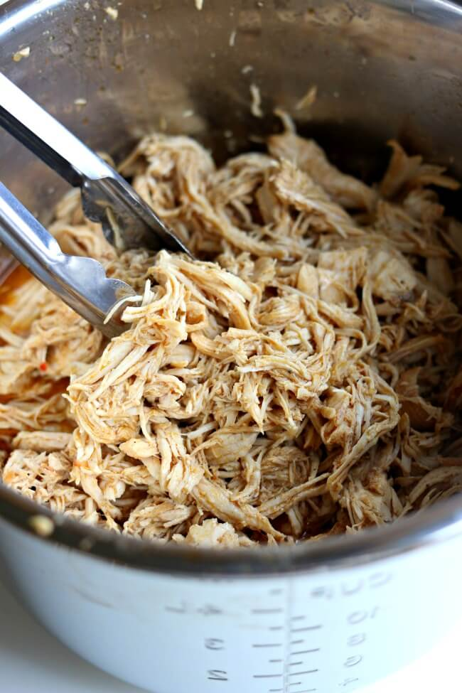 Instant Pot Café Rio Chicken--this quickly cooked shredded chicken is perfect to serve with your Mexican dinners on salads, in burritos, in enchiladas or over rice.