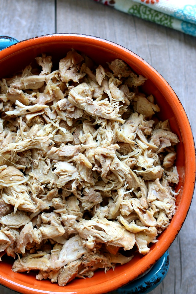 "Instant Pot Seasoned Shredded Chicken--if you love rotisserie-style chicken you need to make this chicken! The chicken is made in minutes in your Instant Pot and it's super tender and moist. My husband said to me, ""I think this is the best chicken you've ever made."""