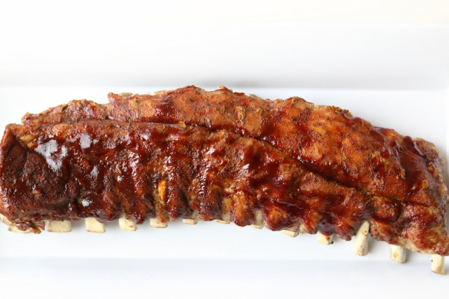 Instant Pot/Slow Cooker St Louis Baby Back Pork Ribs--the best (and easiest) ribs that you can make at home. Fork tender meat that practically falls off the bone. The ribs are seasoned with a dry rub, either pressure cooked or slow cooked, glazed with barbecue sauce, and then stuck under the broiler.