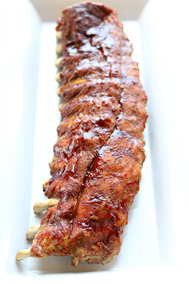 Instant Pot/Slow Cooker St Louis Baby Back Pork Ribs--the best (and easiest) ribs that you can make at home. Fork tender meat that practically falls off the bone. The ribs are seasoned with a dry rub, either pressure cooked or slow cooked, glazed with barbecue sauce, and then stuck under the broiler. The whole process takes only an hour and a half (and that includes marinating time).