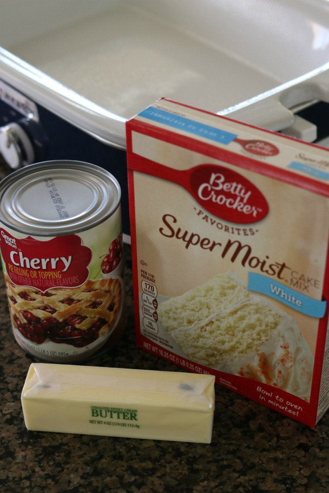 Slow Cooker 3 Ingredient Cherry Dump Cake--all you need to make this recipe is a cake mix, cherry pie filling and butter. Dump all the ingredients in your slow cooker and turn it on. This recipe is so easy and hands off but tastes amazing especially when served with vanilla ice cream.