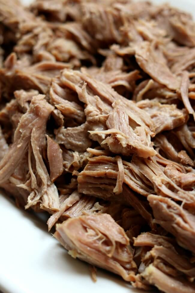 "Instant Pot/Crockpot ""Smoked"" Pulled Pork--if you love pulled pork and you love a smoked flavor on your meat but you don't have hours to spend you're going to love this easy pressure cooker smoky shredded pork."