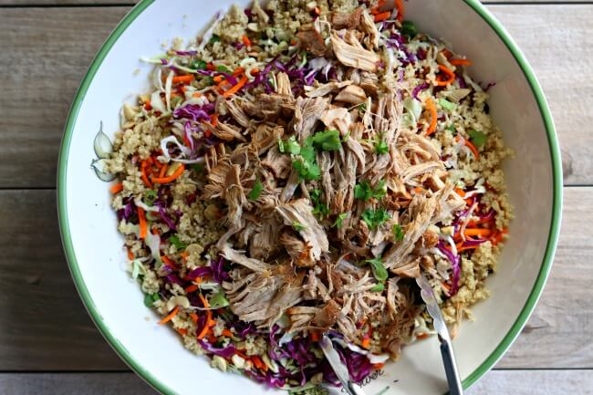 Slow Cooker Chopped Chinese Pork Salad--pork loin is cooked until tender in your slow cooker and then tossed with shredded cabbage, cilantro, green onions, cashews, quinoa and a homemade sesame dressing. This is a perfect summer recipe and it can be made ahead of time.