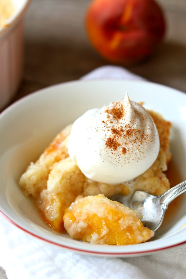 Instant Pot 3-Ingredient Peach Cobbler--fresh peaches, a cake mix and butter are all you need for this simple but totally delicious recipe. Make it quickly in your electric pressure cooker so you can enjoy is faster!