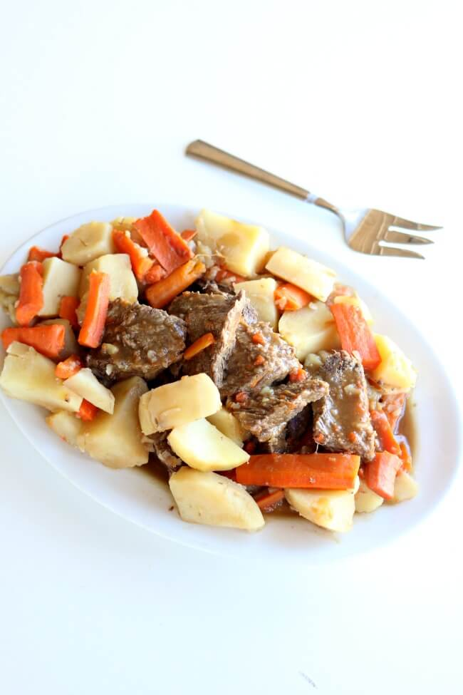 Instant Pot 5-Ingredient Pot Roast Dinner--a chuck roast is cooked until moist and tender in an hour in your Instant Pot (mine was frozen!) along with seasoned vegetables. The meal is finished off with homemade gravy.