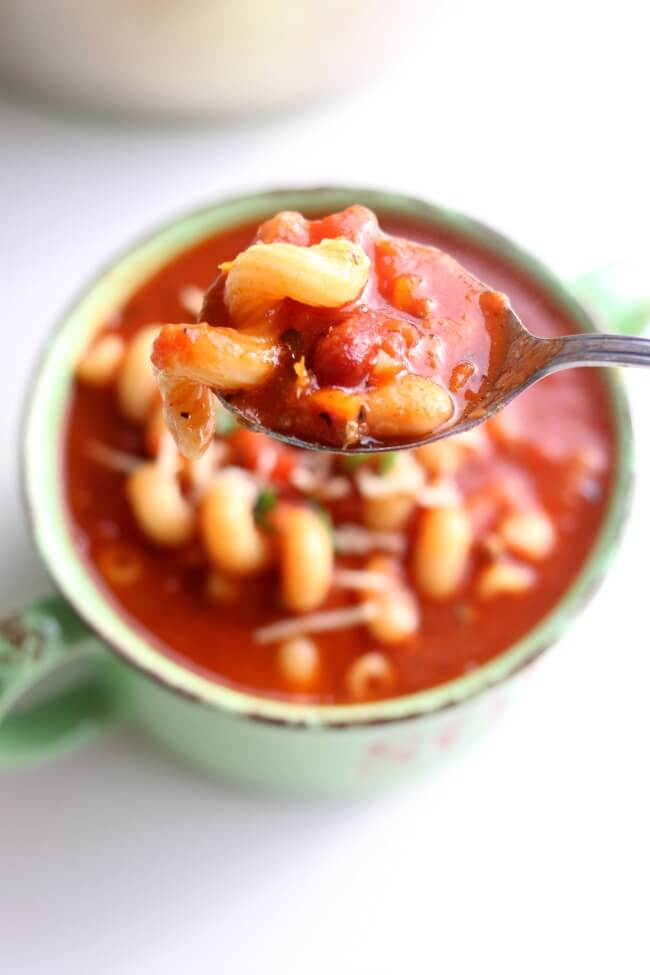 Instant Pot Pasta e Fagioli Soup--your favorite soup from Olive Garden made quickly at home in your pressure cooker. White and red beans, ground beef,  tomatoes and pasta in a savory broth.