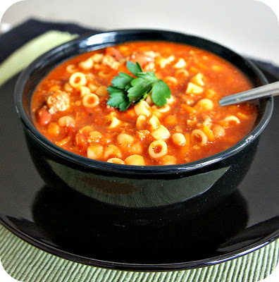 Slow Cooker Pasta e Fagioli Soup--your favorite soup from Olive Garden made at home in your slow cooker. White and red beans, ground beef,  tomatoes and pasta in a savory broth.