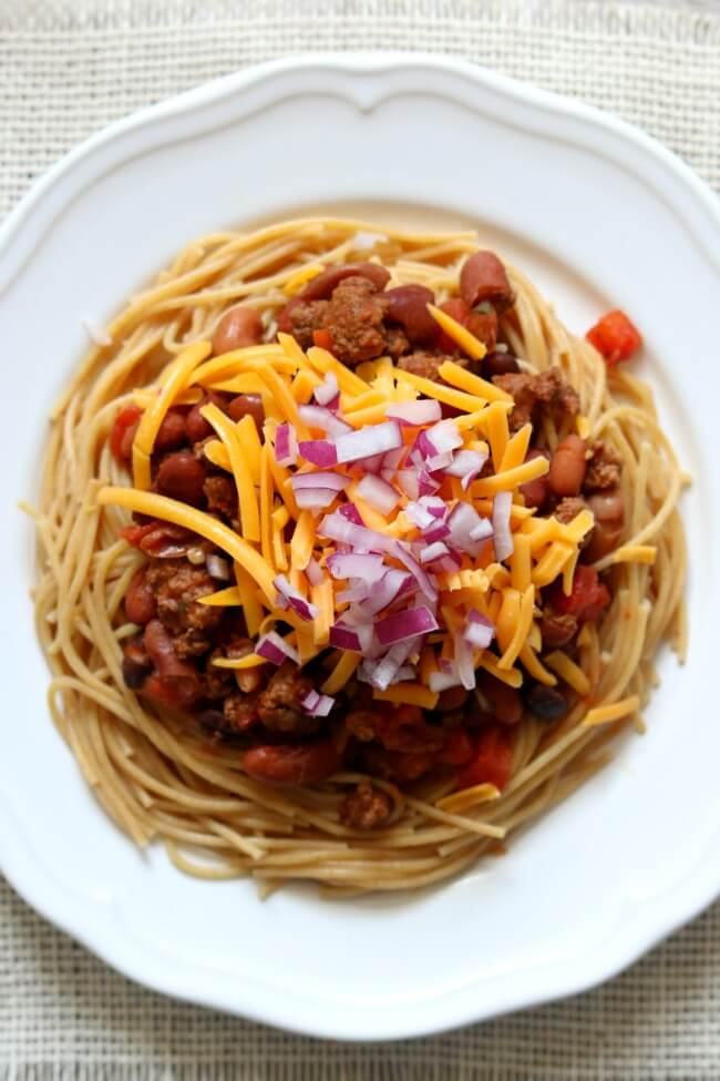 Instant Pot/Slow Cooker Cincinnati Chili--Cincinnati chili is a Mediterranean-spiced meat sauce used as a topping for spaghetti. There are many ways to make it but in this recipe we're going five way: spaghetti, chili with beans, shredded cheese and diced red onions. You can make the chili in the Instant Pot or the slow cooker, it's your choice.