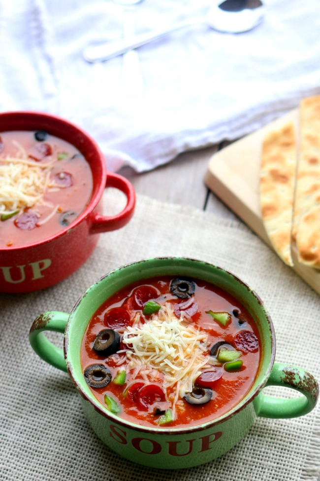 Instant Pot Pizza Soup--Love pizza? Try this soup that tastes like the real deal (minus the crispy crust). It's made in the pressure cooker too so it's extra fast and totally delicious. Add whatever pizza toppings you like to the soup to make it taste even better!