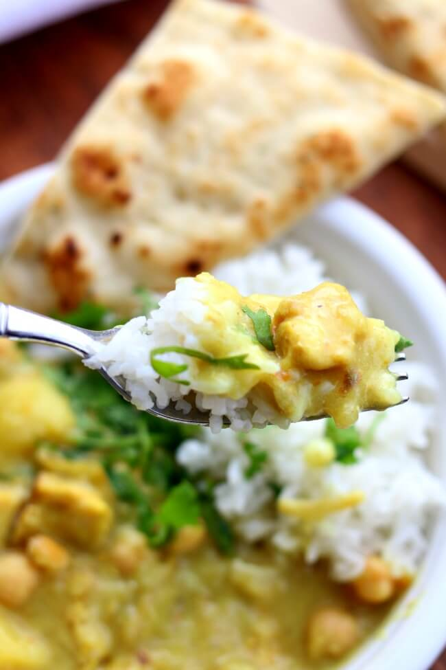 Instant Pot Yellow Chicken Curry and Jasmine Rice--a thai-style coconut curry with moist bites of chicken, tender bites of yellow potatoes, vibrant turmeric and curry powder all made quickly at home in your electric pressure cooker. Bonus: The jasmine rice is cooked at the same time and in the same pot!