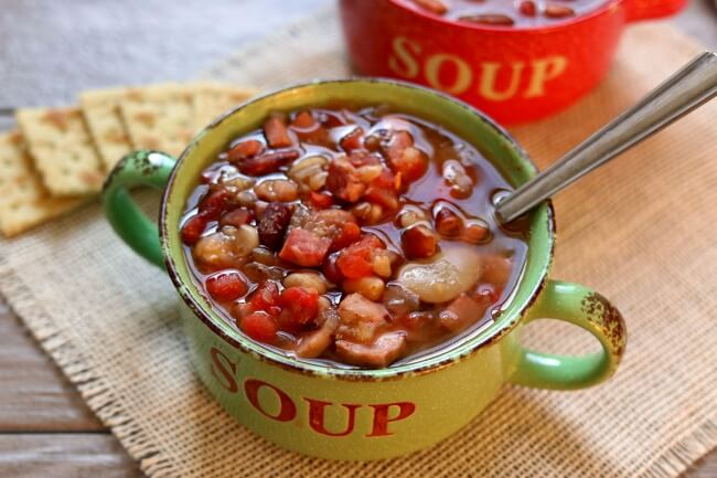 Instant Pot 15 Bean Soup--the classic 15 bean and ham soup recipe made in your electric pressure cooker in less than an hour. With just a handful of ingredients you'll have a hearty and healthy pot of soup in no time.
