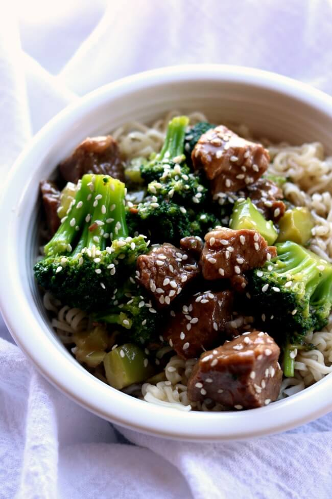 Slow Cooker Beef and Broccoli--tender pieces of beef are served alongside broccoli and a savory and slightly sweet Asian sauce for a homemade version of your favorite Chinese takeout dish.