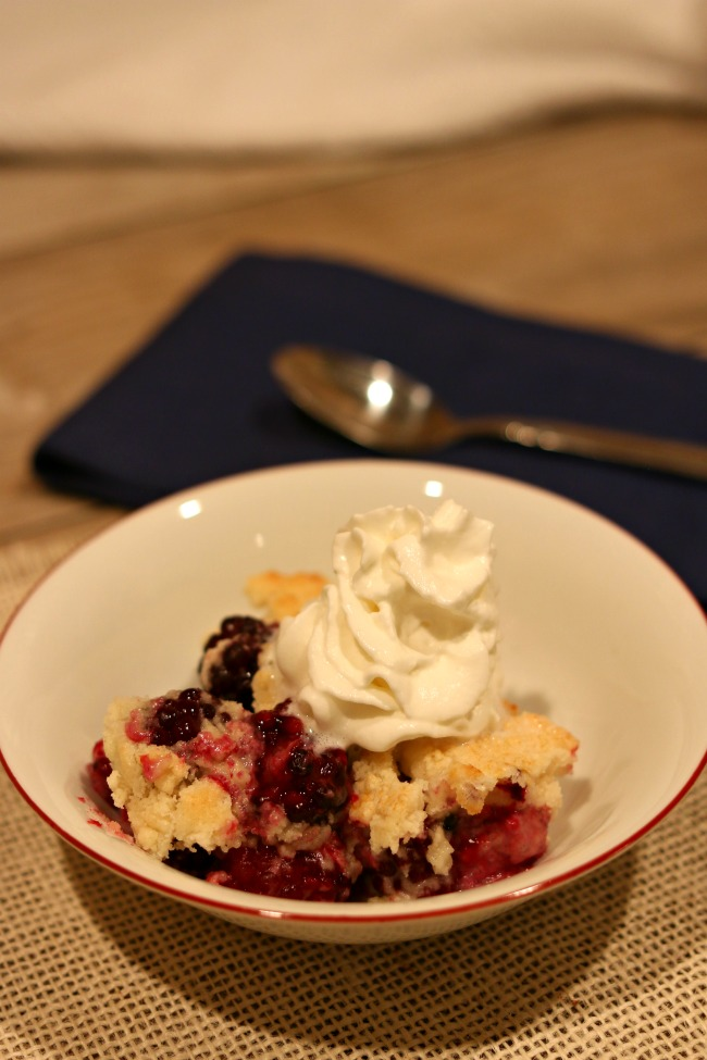 Slow Cooker 3-Ingredient Blackberry Cobbler--fresh blackberries are topped with a white cake mix/butter mixture and cooked in your slow cooker. Serve topped with vanilla ice cream or whipped cream and enjoy an amazing dessert with minimal work and time!