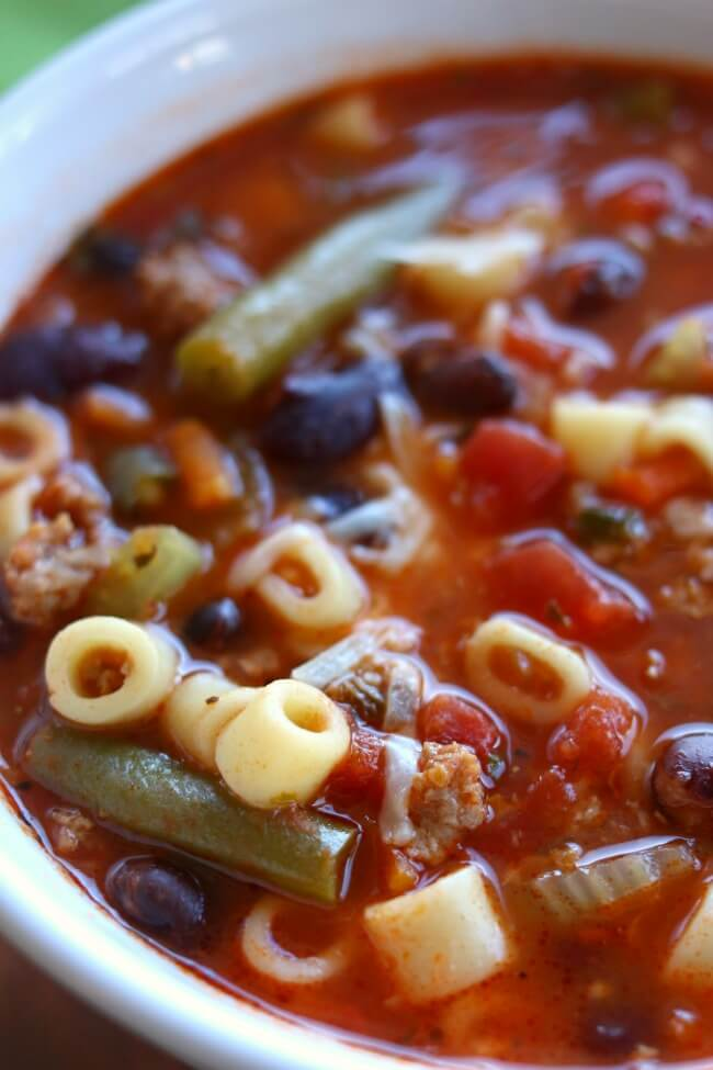 Instant Pot (Ground Turkey) Minestrone Soup--a colorful, healthy and brightly flavored soup that is full of vegetables, basil, beans, pasta, and ground turkey. Pressure cook this soup quickly and enjoy a warm bowl of deliciousness for dinner.