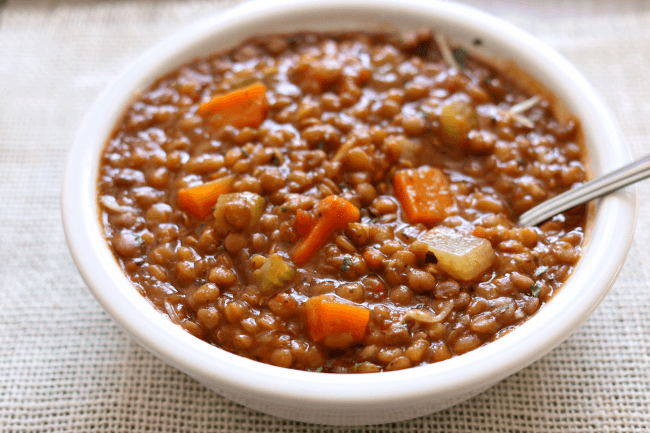 Instant Pot/Slow Cooker Garlic Herb Lentils--easy lentil stew with onions, garlic, carrots and celery. It's almost got a creamy consistency and is super comforting. Make it fast in your pressure cooker or simmer it all day in your slow cooker.