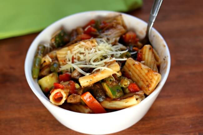 Instant Pot Pasta Primavera–A vegetarian pasta and vegetable dish. Rigatoni pasta is cooked quickly in your pressure cooker along with tomatoes, fresh green beans, carrots, mushrooms, garlic and zucchini.  The whole dish is tossed with grated parmesan cheese.