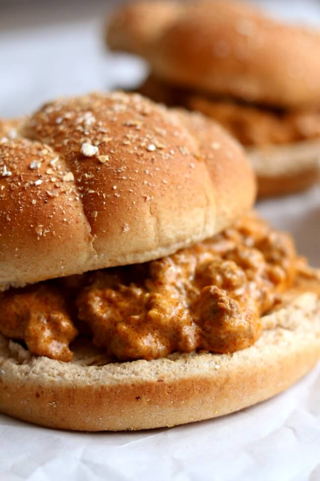 Instant Pot Creamy Sloppy Joes--homemade sloppy joe sauce and ground beef are simmered in the electric pressure cooker and then cream cheese is stirred in as a twist to make the best sloppy joes of your life. Serve the meaty sauce on toasted buns or even slider rolls for an easy weeknight dinner. This recipe can easily be doubled or tripled to serve a crowd.
