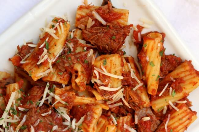 Instant Pot Beef Ragu--tender chunks of beef are braised in a tomato based sauce and tossed with pasta. A super easy recipe to make for any night of the week.