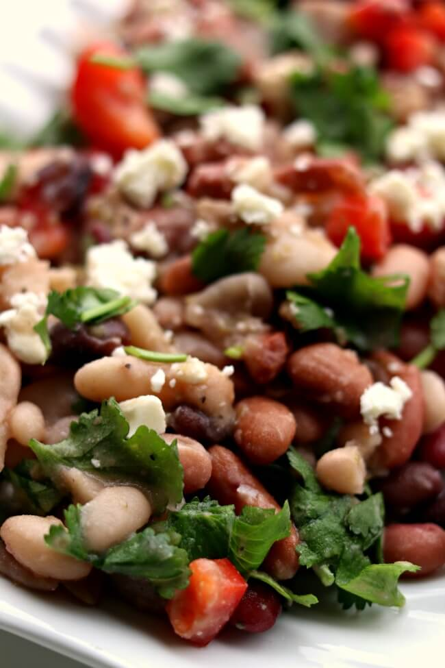 15 Bean Salad --a variety of dried beans are cooked in your electricpressure cooker or slow cooker and then stirred together with a red wine vinaigrettedressing, red bell pepper, feta cheese and cilantro. This salad serves a crowd and is perfect for a potluck or picnic.