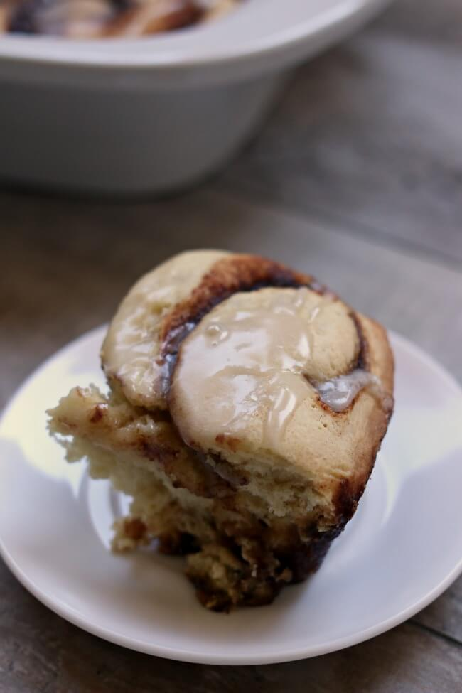 Slow Cooker Cinnamon Rolls--gooey yeast bread cinnamon rolls made easy in the slow cooker. Because they are cooked slowly you don't have to let the cinnamon roll dough raise! Cut out the step of raising the dough twice and just let the cinnamon rolls raise and cook at the same time in the slow cooker.