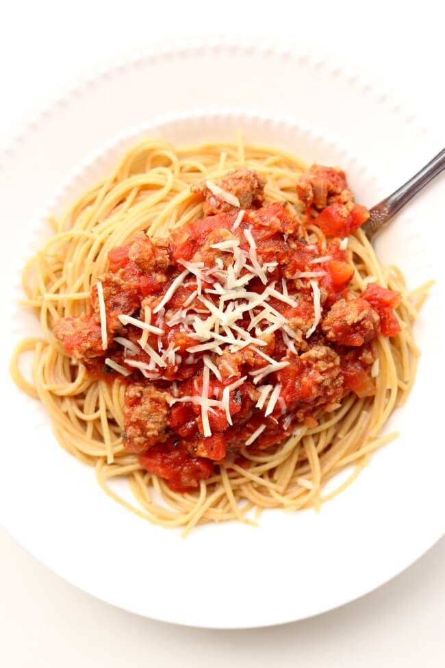 Slow Cooker Homemade Spaghetti Sauce--a meaty slow cooker spaghetti sauce that takes minutes to get going and then simmers all day in your crockpot. I like to serve this sauce over any pasta or over spaghetti squash.